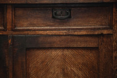 Detail of a vintage cupboard sideboard - drawers with metal handle. vintage retro furniture closeup Stock Image