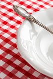 Detail of vintage cutlery on white plate Royalty Free Stock Photography