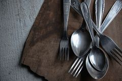 Detail of vintage cutlery on wooden table royalty free stock image