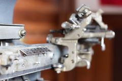 Detail of a vintage dog tag maker machine. stock image