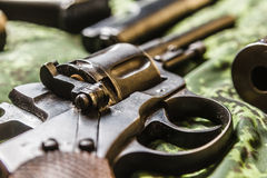 Detail of vintage generic 9mm pistol on pixel camouflage Royalty Free Stock Photo