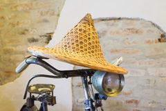Detail of a vintage handlebar of bicycle with yellow hat weave. The Detail of a vintage handlebar of bicycle with yellow hat weave Stock Photo