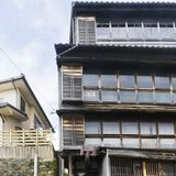 Detail of vintage Japanese wooden house with large windows in wooden frames. In Kanazawa, Japan stock photos