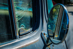 Mirror Mirror. Detail of vintage pickup truck featuring side mirror, cracked wing window and rust Stock Images