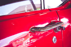 Detail of vintage red car door royalty free stock image