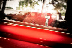 Detail of vintage red car door Royalty Free Stock Photos