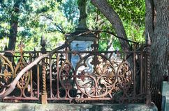 Detail of vintage rusty iron fence in neglected Toowong cemetery near Brisbane Queenland Australia 8 23 2015 stock image