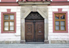 Detail of vintage townhouse in Czech with old door and windows. Details of vintage townhouse in Czech Republic with old wooden door and windows Royalty Free Stock Image