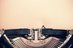 Detail of vintage typewriter with blank  paper Royalty Free Stock Images