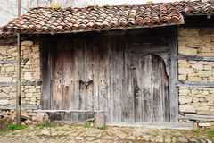 Detail of vintage wooden door, stone wall Stock Images