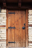 Detail of vintage wooden door, stone wall Royalty Free Stock Image