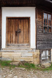 Detail of vintage wooden door and windows of the old wood house Stock Photography