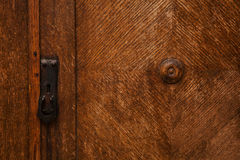 Detail of vintage wooden furniture. door hole for the key. Background and texture of natural wood. Space for text Stock Image