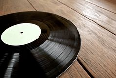 Detail of vinyl record. On wooden table Royalty Free Stock Photos
