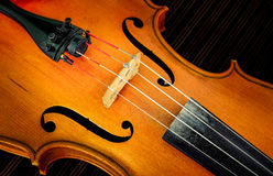 Detail of violin in filtered glow style Stock Images