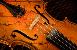 Detail of violin in filtered style as cracked paint Stock Photo