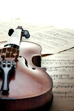 Detail of violin on sheet music Royalty Free Stock Photos