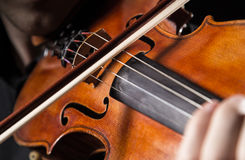 Detail a violinist playing his instrument. Classic music concept Stock Photo