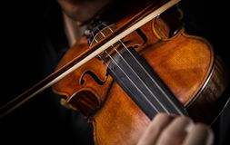 Detail a violinist playing his instrument. Classic music concept Royalty Free Stock Photo