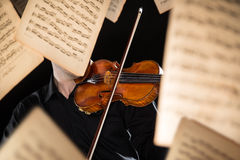 Detail a violinist playing his instrument. Classic music concept Stock Photos