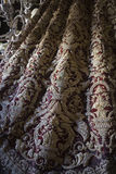 Detail the Virgin's mantle embroidered on red velvet Royalty Free Stock Photo