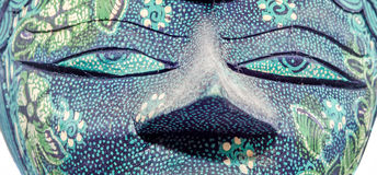 Detail of vivid colored african mask, halloween mask, close up isolated Royalty Free Stock Photo