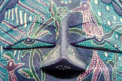 Detail of vivid colored african mask, halloween mask, close up isolated Stock Images
