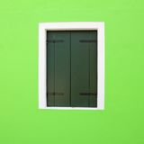 Detail of vivid green facade with window Stock Image
