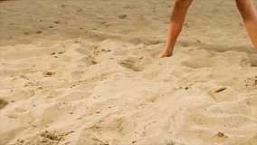 Detail of volleyball female player at the beach. Scene. Close-up of a woman on the sand playing beach volleyball stock photos