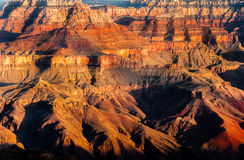 Detail von Grand Canyon -Felsen fomation bei buntem Sonnenaufgang Stockfotos