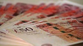 Detail von 50-Pfund-Banknoten mit dem Gesicht der Königin des Vereinigten Königreichs Stockbild