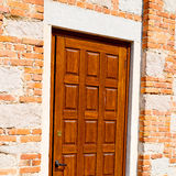 detail in  wall door  italy land europe architecture and wood th Stock Photos