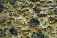 Detail of a wall made with rocks in Crete. Greece, edge, black, crack, decorative, old, border, rustic, coarse, raw, gray, firm, stone, brown, solid, gap stock photo