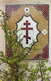 Detail of a wall with a mosaic in the shape of a cross Stock Images
