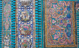Detail of a wall of an old iranian mosque with mosaics and tiled pieces in persian style, Kermanshah, Iran. Royalty Free Stock Photography