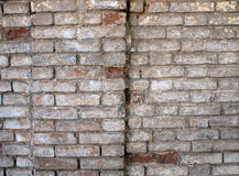 Detail of a wall of an old red brick with white coating Royalty Free Stock Images