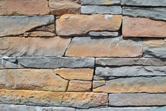 Detail Of The Wall. That was built of stone slabs of irregular shape and different size and thickness of the red and blue Royalty Free Stock Images