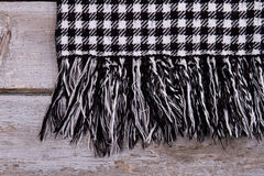 Detail of warm checkered scarf with fringe. Royalty Free Stock Images