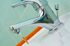 Detail of water faucet in bathroom Royalty Free Stock Images