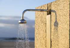 Detail of a water shower on the beach Stock Image