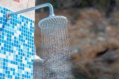 Detail of a water shower on the beach in horizontal composition.  royalty free stock photography