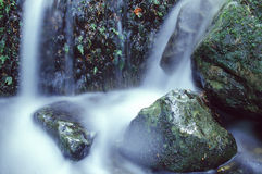 Detail of a waterfall. Close-up of a waterfall in the french Vosges moutains. With tripod and long exposure time Royalty Free Stock Image