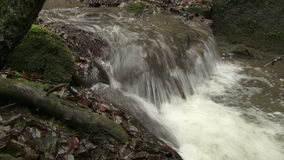 Detail of waterfall in brook. Slider with horizontal motion was used for shot stock footage