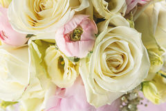 Detail of wedding bouquet on pink background, pink and ivory bouqet, holiday celebration Royalty Free Stock Photos