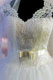 Detail of a wedding dress Stock Images