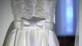 Detail on the wedding dress. Detail on the wedding dress, wonderful dress for a bride stock footage