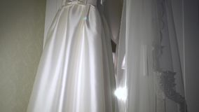 Detail on the wedding dress-2. Detail on the wedding dress, wonderful dress for a bride stock video