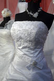 Detail of a weddings dress. On mannequin Stock Photos