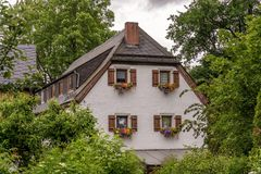 Old traditional farmhouse in the middle of green nature royalty free stock photo