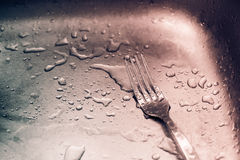 Detail of wet fork and drops Royalty Free Stock Photo